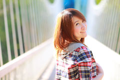 Closeup portrait of the asian girl 20 years old posing outdoors wear plaid shirt. Head and shoulders ,park view in the afternoon in warm color tone Royalty Free Stock Photography