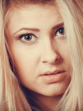 Closeup portrait of attractive blonde woman face. Beauty of femininity concept. Closeup portrait of attractive blonde young woman face with dark brown eyes Royalty Free Stock Images