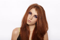 Closeup portrait of attractive cute redhead woman with violet smokey eyes makeup looking into camera isolated. Closeup portrait of attractive cute redhead lady Royalty Free Stock Photography
