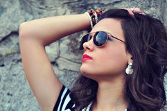Closeup portrait of an attractive girl. Closeup portrait of an attractive brunette girl wearing sunglasses Stock Image