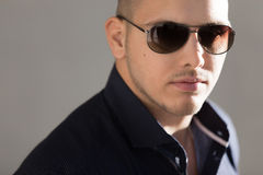 Closeup portrait of attractive guy in sunglasses Stock Images