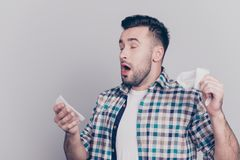 Closeup portrait of attractive man sneezing with open mouth prep royalty free stock image