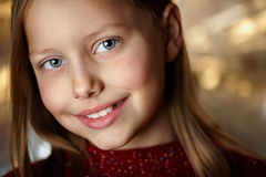 Closeup portrait of attractive smiling little girl Stock Images