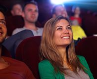 Closeup portrait of attractive woman in cinema Stock Images