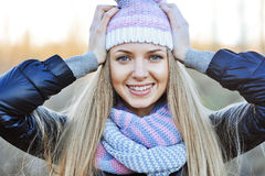 Closeup portrait of attractive young blonde girl with hands next Royalty Free Stock Photos