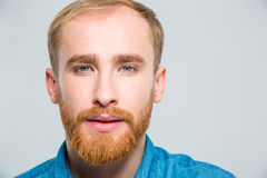 Closeup portrait of attractive young man with beard Stock Photo