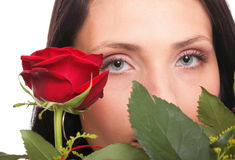 Closeup portrait of attractive young woman holding a red rose Royalty Free Stock Photo