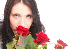 Closeup portrait of attractive young woman holding a red rose Stock Image