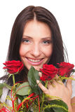 Closeup portrait of attractive young woman holding a red rose Royalty Free Stock Photography