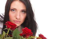 Closeup portrait of attractive young woman holding a red rose Stock Photo