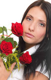 Closeup portrait of attractive young woman holding a red rose Stock Images