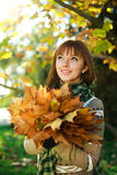 Closeup portrait of autumn girl with leaves Stock Photography