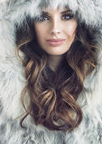 Closeup portrait of a beautiful brunette woman Stock Photos