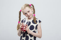 Closeup Portrait of Beautiful Caucasian Blond Girl With Pigtails Posing in Polka Dot Dress Against White. Stock Images