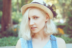Closeup portrait of beautiful Caucasian teenage young blonde alternative model girl woman in blue tshirt Royalty Free Stock Photography