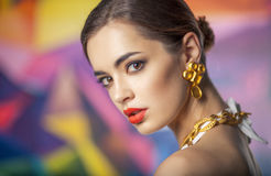 Closeup portrait of beautiful caucasian woman on colorful backgr Stock Photo