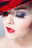 Closeup on elegant pretty woman with red lips & hat, crystals Stock Photo