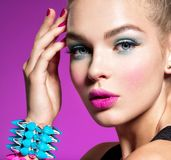 Fashion portrait of a beautiful woman with bright makeup stock images