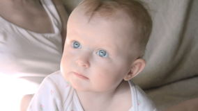 Closeup portrait of beautiful gentle mother playing with cute little baby stock video