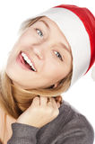 Closeup portrait of beautiful girl. In a Santa Claus hat, a beautiful white teeth smile,isolated on white Royalty Free Stock Images
