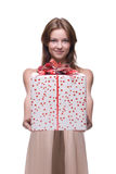 Closeup portrait of beautiful girl with huge gift Royalty Free Stock Image
