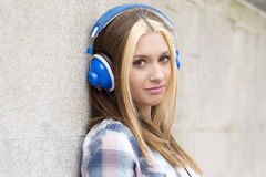 Closeup portrait beautiful girl listen music with headphones. Stock Photography