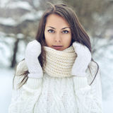 Closeup portrait of a beautiful girl in a winter park Royalty Free Stock Images