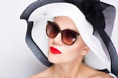 Woman white sunhat. Closeup portrait of beautiful girl woman lady with professional make up big sunhat. Luxury accessory New Bright color makeup, shiny lipstick Royalty Free Stock Photo