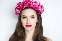 Woman pink roses. Closeup portrait of beautiful girl woman lady with volume combed hair styling. Luxury Bright makeup shiny lipstick cosmetics. New Professional Royalty Free Stock Images