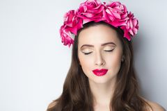 Woman pink roses. Closeup portrait of beautiful girl woman lady with volume combed hair styling. Luxury Bright makeup shiny lipstick cosmetics. New Professional Royalty Free Stock Photos