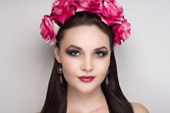 Woman pink roses. Closeup portrait of beautiful girl woman lady with volume combed hair styling. Luxury Bright makeup shiny lipstick cosmetics. New Professional Stock Photo