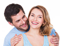 Closeup portrait of beautiful happy couple. Closeup portrait of attractive smiling couple isolated on white background. Attractive men and women being playful stock photography