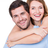 Closeup portrait of beautiful happy couple. Closeup portrait of beautiful happy couple isolated on white background. Attractive men and women being playful stock photography