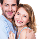 Closeup portrait of beautiful happy couple. Closeup portrait of beautiful happy couple isolated on white background. Attractive men and women being playful royalty free stock photography