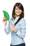 Smiling business woman holding eco leaf Royalty Free Stock Photography
