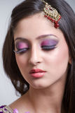 Closeup portrait of a beautiful indian bride. With purple makeup Royalty Free Stock Photos