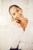 Closeup portrait of beautiful Indian businesswoman talking using Stock Photos