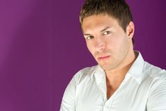 Closeup portrait of a beautiful man. In a white shirt royalty free stock images