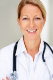 Closeup portrait of beautiful mature female doctor Stock Images