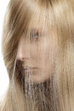 Closeup  portrait of beautiful model with blond hair covering he Royalty Free Stock Photo