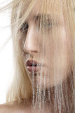 Closeup  portrait of beautiful model with blond hair covering he Stock Photo