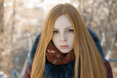 Closeup portrait of beautiful serious girl in winter Royalty Free Stock Image