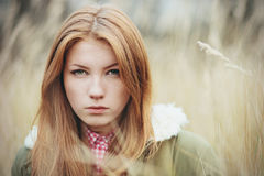 Closeup portrait of a beautiful serious redhead woman Royalty Free Stock Photo