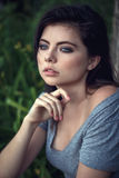 Closeup portrait of beautiful sexy young Caucasian woman with black hair, blue eyes, looking away Stock Images