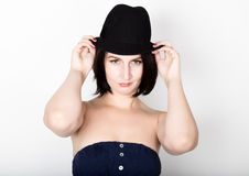 Closeup portrait of beautiful sexy young woman in black hat, posing Stock Photo