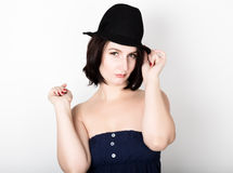 Closeup portrait of beautiful sexy young woman in black hat, posing Royalty Free Stock Image