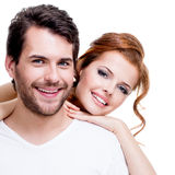 Closeup portrait of beautiful smiling couple. Closeup portrait of beautiful smiling couple posing at studio over white background stock image