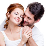 Closeup portrait of beautiful smiling couple. Stock Photos