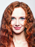 Closeup portrait of beautiful smiling redhead girl Royalty Free Stock Image