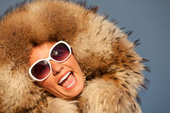 Closeup portrait of beautiful smiling young woman in fur Royalty Free Stock Images